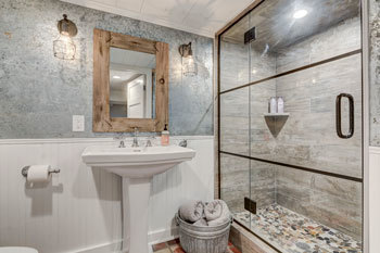 Basement bathroom remodel with metal accents